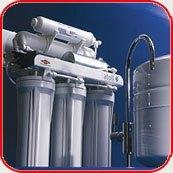 Картинка. Установка фильтра очистки воды в квартире, коттедже или офисе в Калтане